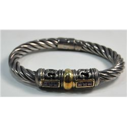 David Yurman? maybe sterling & gold bracelet