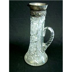 Tall cut glass pitcher