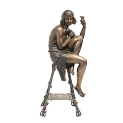 "Bronze figure ""Seated Nude Woman with Cup"""