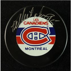 Gilbert Dionne Signed Canadiens Logo Puck (Online COA)