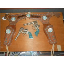 Turquoise handled Long Horn Western Cap Guns with Decorative Holsters  Note hammers on  both guns ar