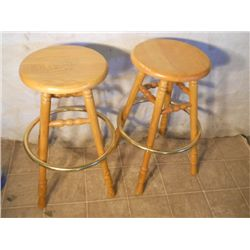 2 oak spinning bar stools