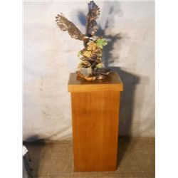 tall wood stand w/ plastic eagle attached