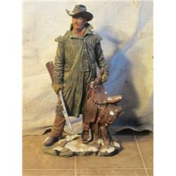 Cast Mountain Man With His Rifle Holding Saddle
