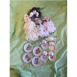 4 Tiny Porcelain Dolls With A Mini Mouse Tea Set