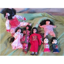7 Asian Porcelain, Wood And Plasic Dolls