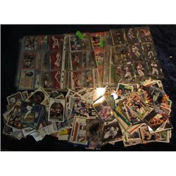 1517. (775) Loose and (600) in Pages Football & Baseball Cards.