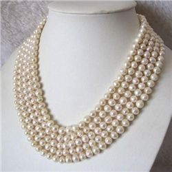 Stunning WHITE AKOYA PEARL NECKLACE measures 100 in