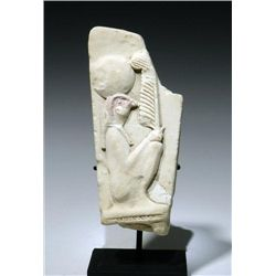 An Egyptian Limestone Relief Fragment Horus
