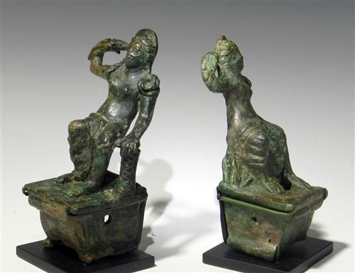A pair of roman bronze chariot fittings