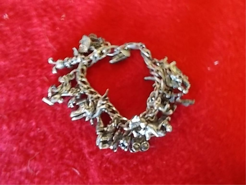 Image 1 Disney Charm Bracelet Marked 925 Silver Several Charms