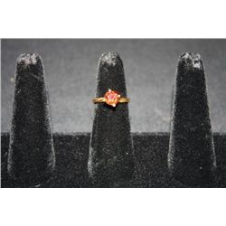 18KT YELLOW GOLD COLORED CZ RING-- COLOR IS BURNT ORANGE/RED SZ-6