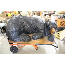"""CARVED ART BEAR LAYING ON LOG - APPROX. 150 LBS. - 24"""" HIGH - 43"""" LONG - 25"""" WIDE - WILL NOT SHIP -"""