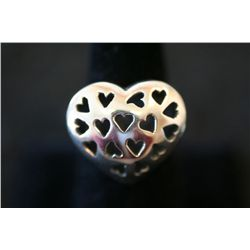 Sterling Silver Heart Shaped Ring W/Small Heart Cut-Outs in Ring