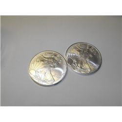 (2) Silver Eagles Random years