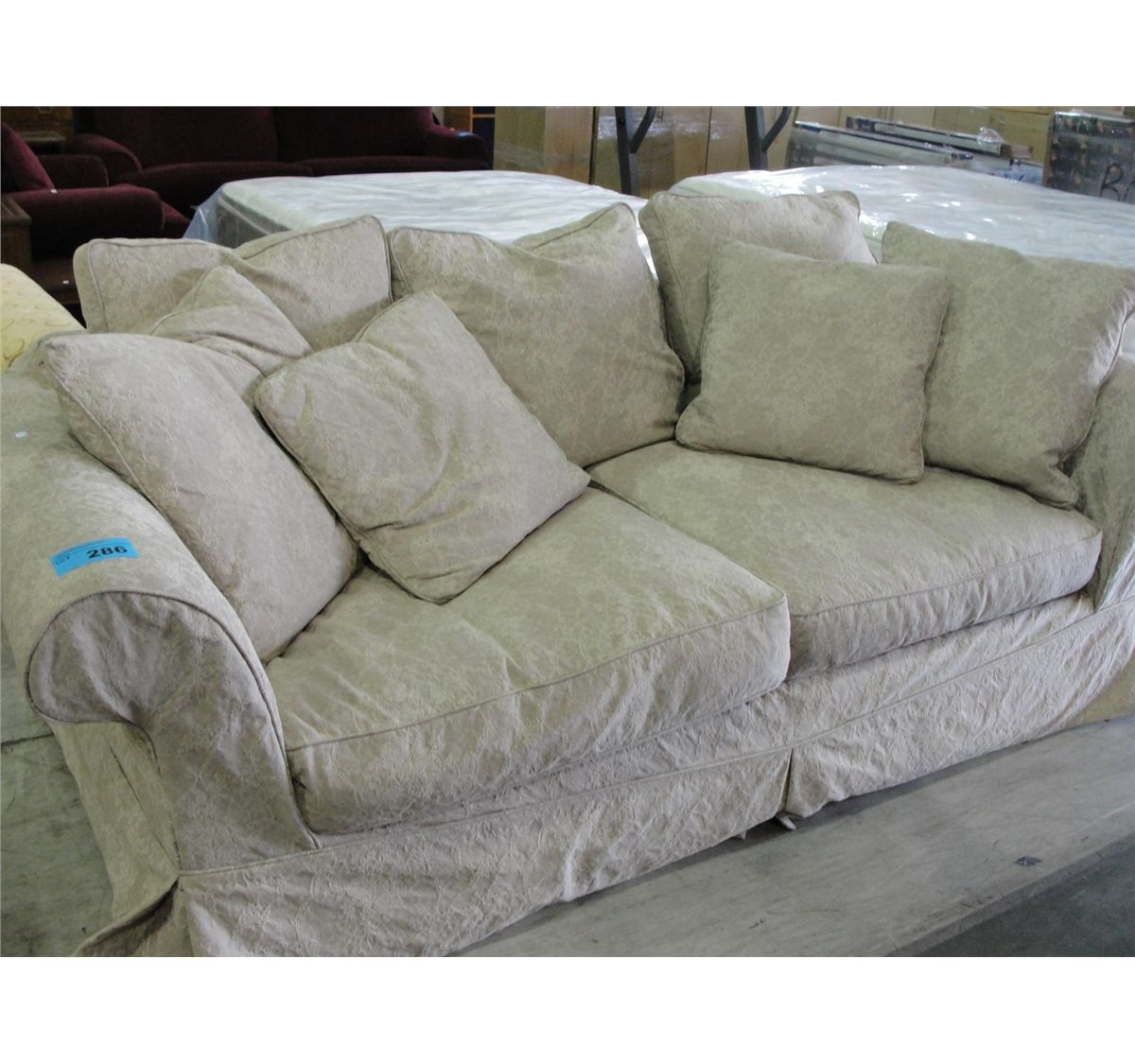 Contemporary overstuffed sofa with throw cushions