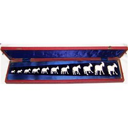 Set of Eleven Ivory Donkeys in a Custom Case.