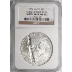 2004 1 oz. silver Eagle  PCGS67  mint error strike thru