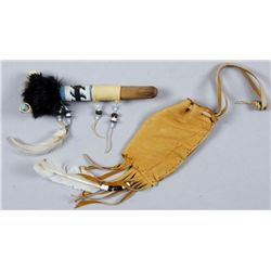 Indian Pipe and  Buckskin BagThe pipe has a blue and white beaded design.  This the type found in tr