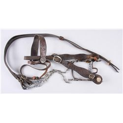 Western Headstall with Bit and ReinsUnmarked bit, the headstall is floral tooled  with $1 conchos, i