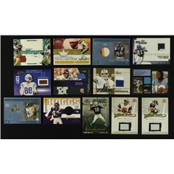 Lot of (13) Football Game-Worn Memorabilia Cards With Faulk, Warner, Moss, Aikman, Sanders