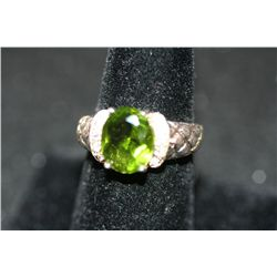 Sterling Silver Ring W/Oval Shaped Green Gemstone Surrounded By White Gemstones
