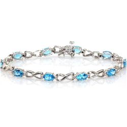Genuine London Blue Topaz 5.28 ctw Bracelet 10KTGold