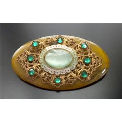 VINTAGE BAKELITE BROACH GOLD TONE WITH GREEN RHINESTONES