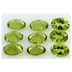 Peridot 12.08 ctw Loose Gemstone 6x8mm Oval Cut