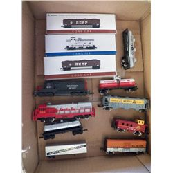 Small electric trains some on boxes