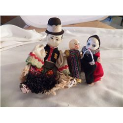 "3- Celluloid Dolls approx man with hat 6"", other 2 are 4"""