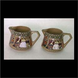 Pair of Buffalo Pottery Emerald Deldare creamers. Dr. Syntax with  the dairy maid. One artist signed