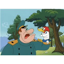 Original production cel of Woody Woodpecker with production background