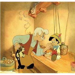 Cels of Pinocchio, Geppetto and Figaro with the key watercolor production background from Pinocchio