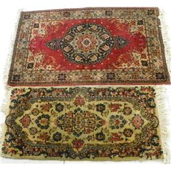 Ivory Kerman rug & red machine made scatter