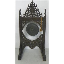 Gong mounted on heavily carved stand