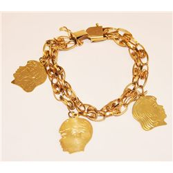 14kt gold charm bracelet with 3 charms