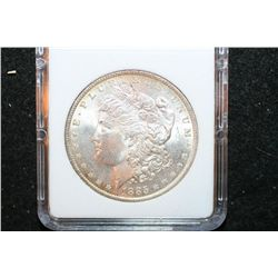 1885-O Silver Morgan $1; MCPCG Graded MS64