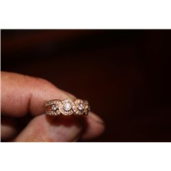 14 K LADIES BAND OVER A CARAT IN DIAMONDS 44- 2PTS + 4.8 PTS. 4.4 DWT APPROX SIZE 6  1750  1950