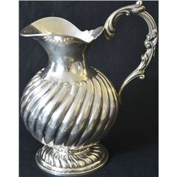 Antique sterling silver pitcher with baroque handle