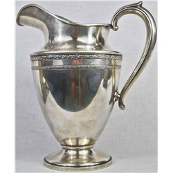 Antique large sterling silver pitcher. Hallmarked