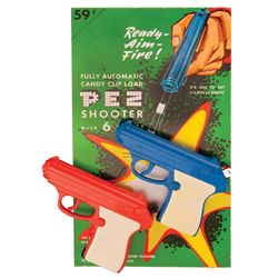 (2) 1960S PEZ CANDY SHOOTERS WITH STORE CARD