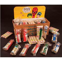 1970S SUPERHERO DISPLAY BOX WITH PEZ CANDY AND DISPENSERS.