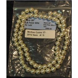 """95. New 20"""" Genuine 6.5-7mm Pearl Necklace with 14K Yellow Gold Clasp. Still in original packaging,"""