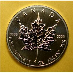 2012 BU CANADIAN MAPLE LEAF, ONE OUNCE .9999 SILVER