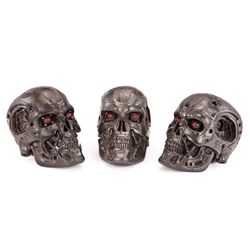 TRIO OF T-700 ENDO SKULLS FROM FACTORY ASSEMBLY SCENE IN TERMINATOR 4: SALVATION
