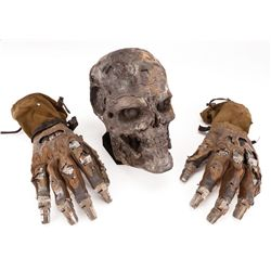 CHARRED T-600 ENDO SKULL AND PAIR OF ENDO GAUNTLET GLOVES FROM TERMINATOR 4: SALVATION