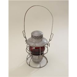 Older metal and red glass lens railroad  lantern by Adlake in very good condition with  long metal h