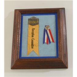 Framed and matted display of two early  reception ribbons/pins for Cowboy and Actor  Tim Holt, one i