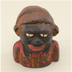 Young N-word cast iron bank, traces of  original paint, about 50% fair to good  overall. Est. $100-$